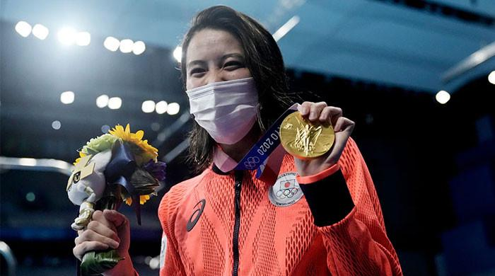 Tunisia, Japan celebrate shock gold medals on day of upsets in Olympic pool