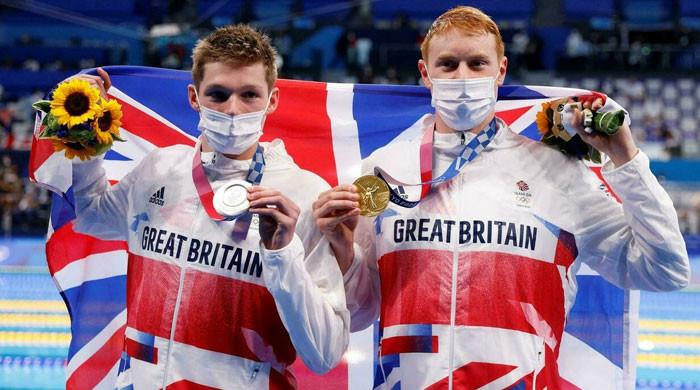 Britain's Tom Dean edges out Scott to claim freestyle Olympic gold