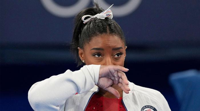 Tearful Simone Biles says 'mental health concerns' were behind shock Olympic exit
