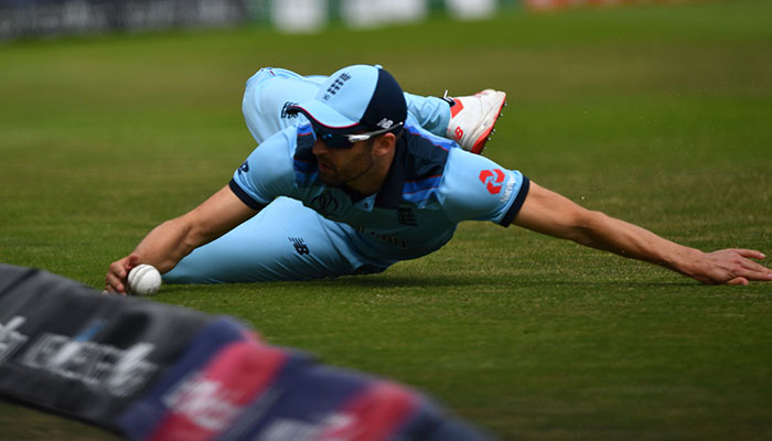 England´s Mark Wood stops a ball at boundary. Photo: AFP