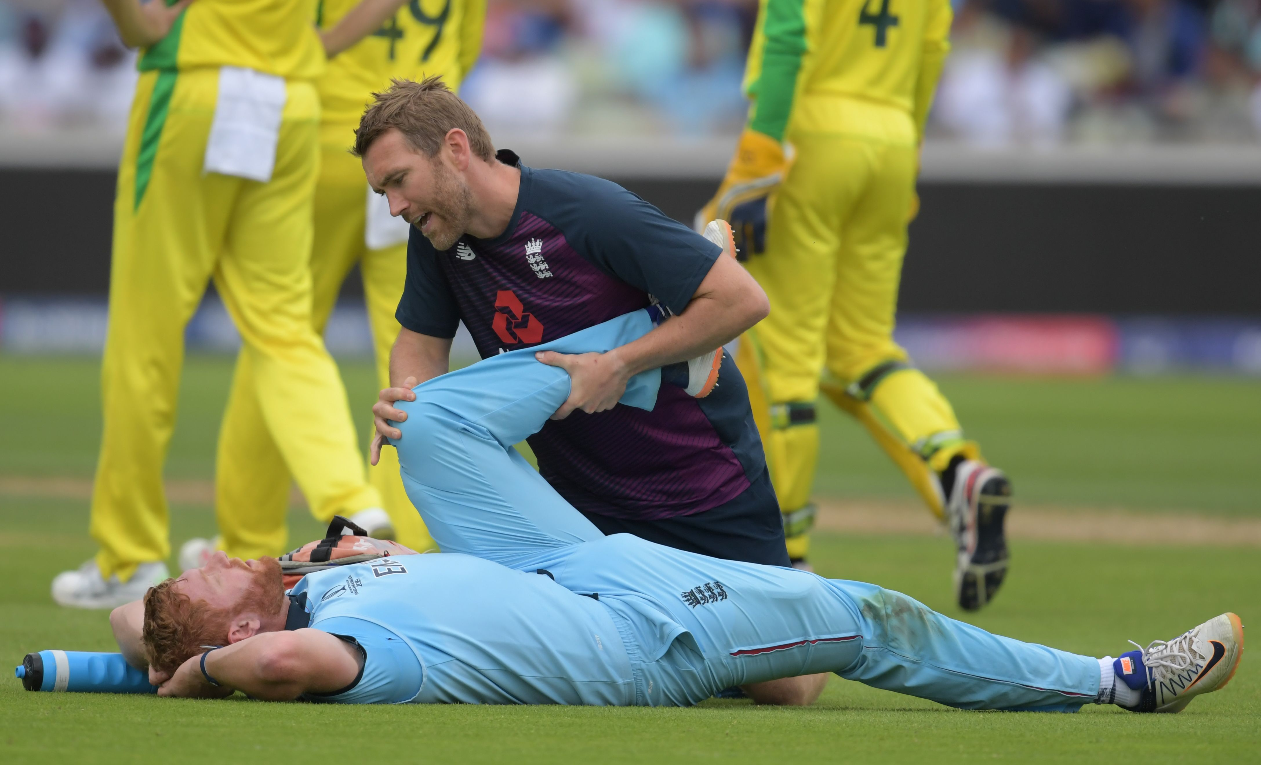 onny Bairstow (R) looks on as he receives medical attention. Photo: AFP