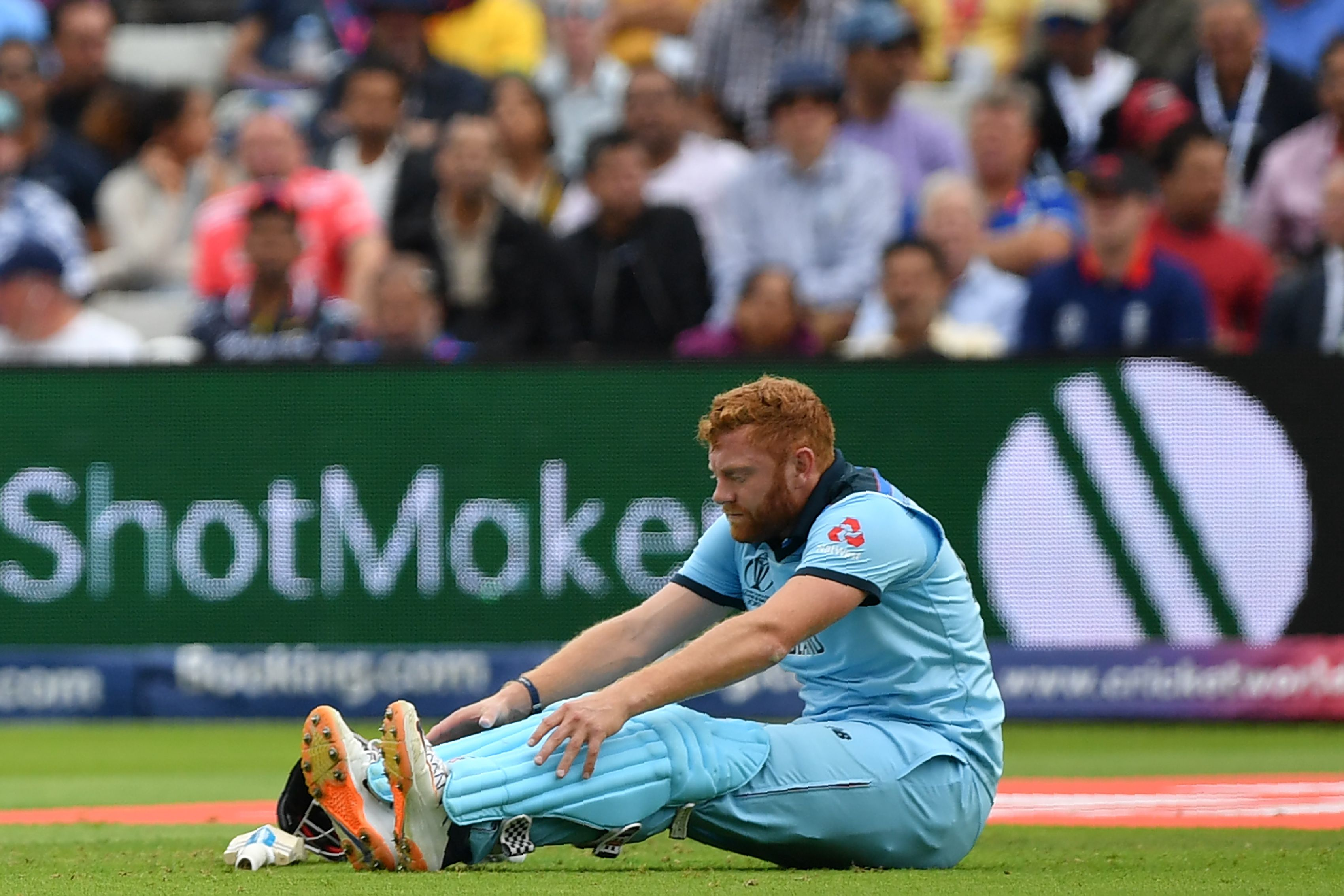 Jonny Bairstow sits on the field as he nurses an injury. Photo: AFP