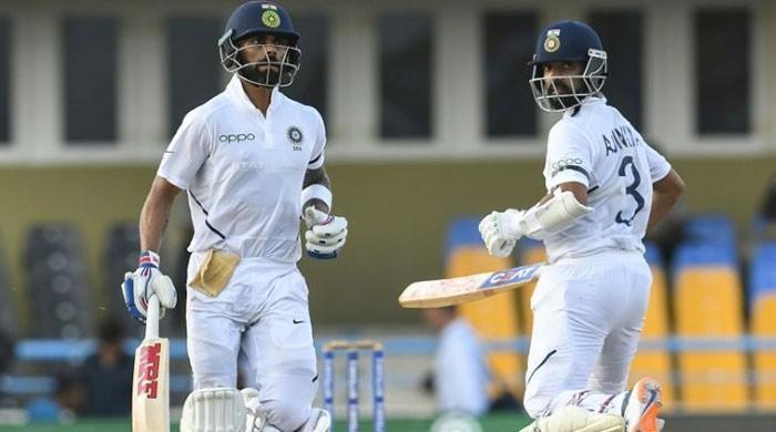 Kohli, Rahane stretch India lead as Cummins crawls to 95-minute duck
