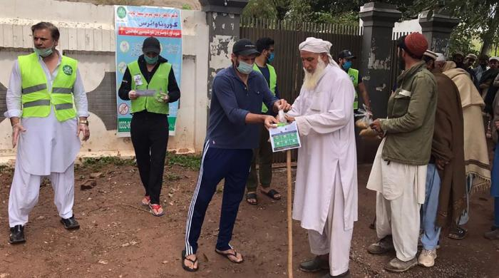 Shahid Afridi distributes ration bags to needy in Dir, Kalaam