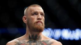 Conor McGregor all smiles after stepping out in crutches, cast
