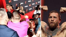 UFC champ Conor McGregor throws a punch at Machine Gun Kelly at VMAs